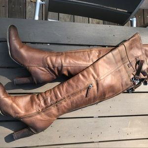 Knee-high brown leather boots with thick heel